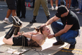 BDSM-Paar - Top and Bottom - Tied on Pavement at Folsom Street Fair 2006.png
